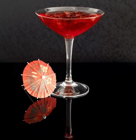 mini umbrella: Vodka and cranberry juice cocktail with crushed ice Stock Photo