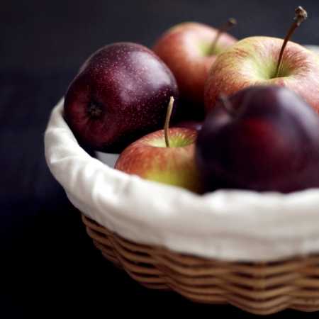 Close up of a basket of red apples photo