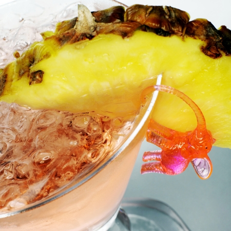 Cocktail with pineapple and pink elephant photo