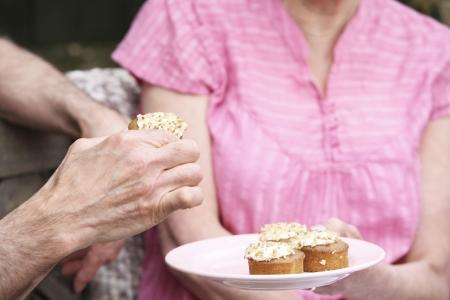 Senior man and woman enjoying their teatime