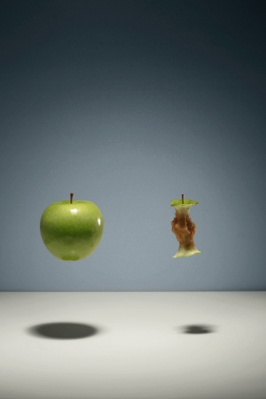 apple core: Green apple and apple core floating in the air