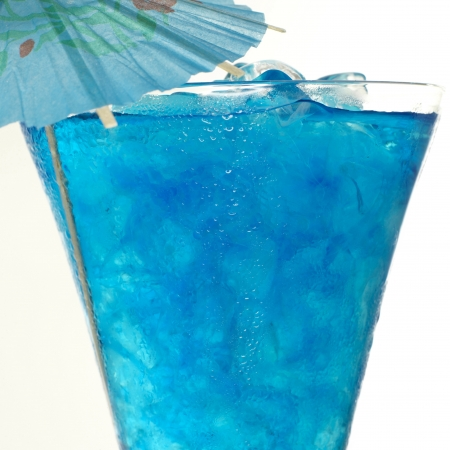 Blue Curacao cocktail with ice and umbrella photo