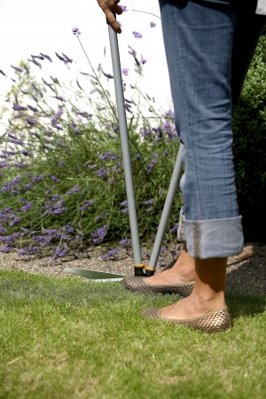 edging: Woman using lawn edging shears
