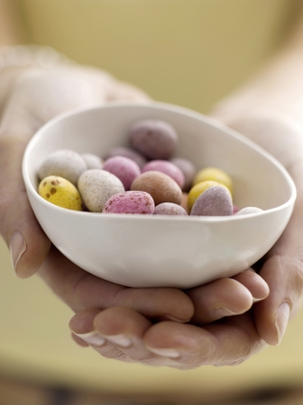Mini eggs in bowl with model photo