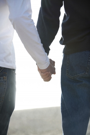 Two guys holding hands photo