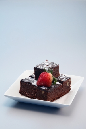 Brownies with icing sugar and strawberry Stock Photo
