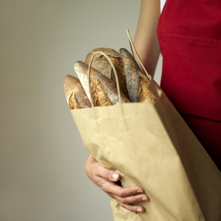 A woman holding a bag of breads photo