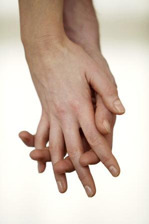 Intimate couple hand in hand Фото со стока