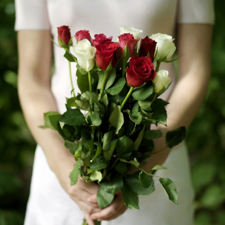 Woman holding a bouquet of flowers photo