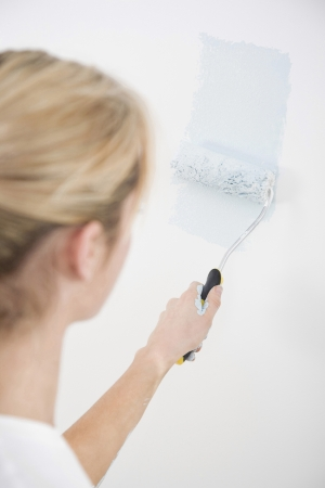 Woman painting wall photo
