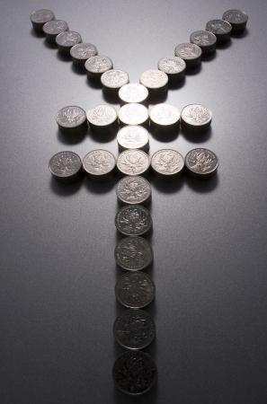 yen sign: Coins making a yen sign Stock Photo