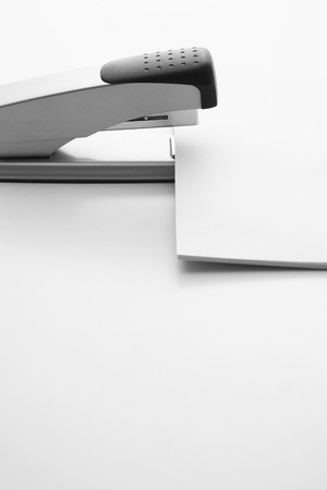 fastening objects: Fastening papers with a stapler Stock Photo