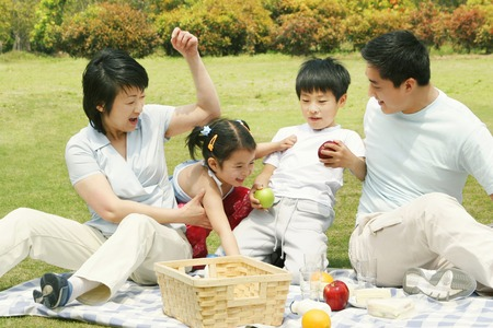 bonding: A family picnicking in the park