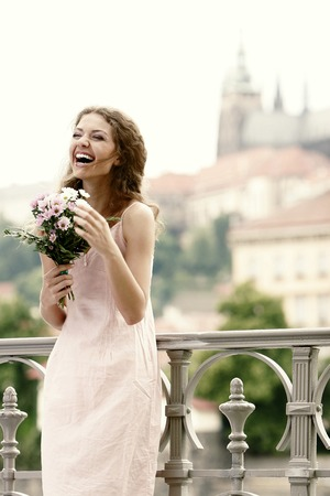 contented: A lady happily holding a bouquet of flowers Stock Photo