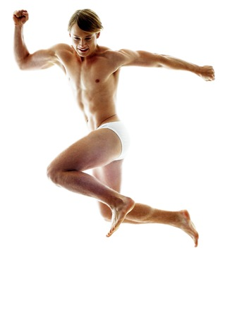 inner wear: A shirtless man in white underwear jumping with his hands opened