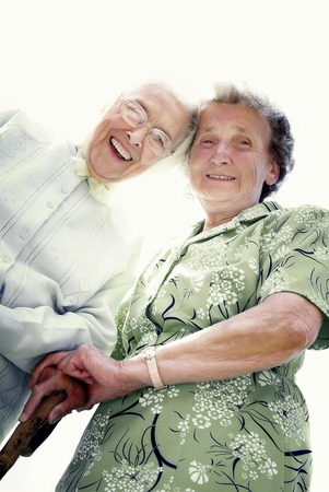 Low angle view of two old women smiling at the camera photo