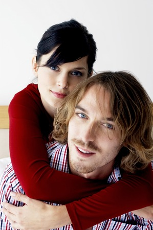 adoring: A lady locking her hands around her boyfriends neck Stock Photo