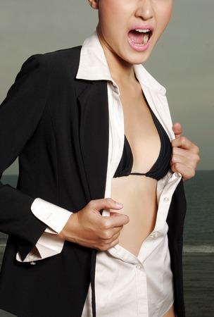 arousing: A lady unbuttoning her shirt exposing her bra
