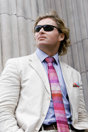 colourful tie: A man in business suit and colourful tie with a sunglass Stock Photo