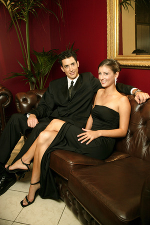 dinner wear: A couple in dinners wear sitting in the waiting room Stock Photo