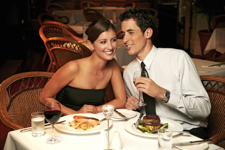 dinner wear: A guy whispering to his girlfriend