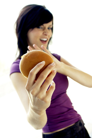 withhold: A lady refraining herself from eating a cheese burger