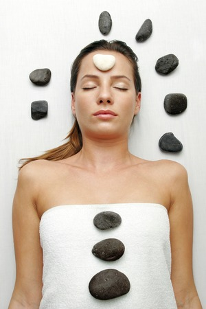 spoiling: A sleeping lady with a white stone on her forehead and black stones on her body and around her head