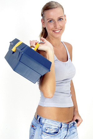 A woman carrying a tool box photo