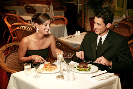 dinners: A couple in dinners wear celebrating their anniversary by eating in the restaurant