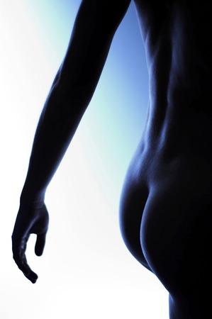 Volver foto de la nalga de una mujer desnuda Foto de archivo - 26133965