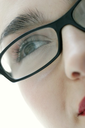 black rimmed: Close-up picture of a ladys face with black rimmed spectacles