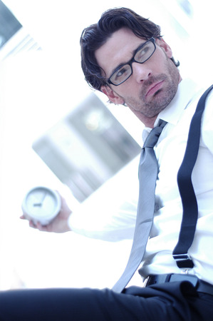 bespectacled man: A bespectacled man holding a clock