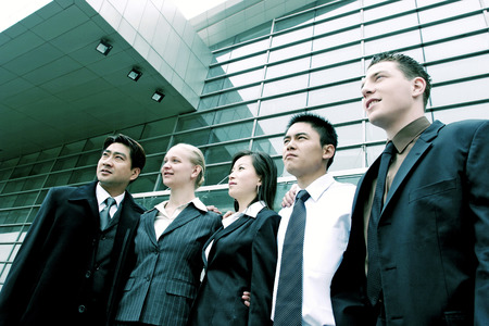 Career men and women standing in a row photo