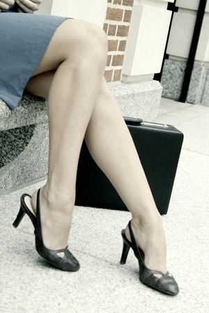 A pair of sexy legs wearing black high heels photo
