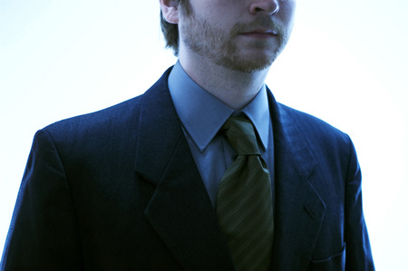 A man in blue coat and striped tie Imagens