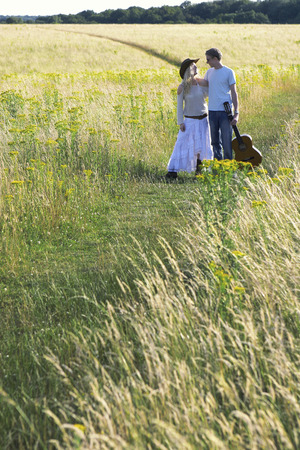 A couple walking together in the prairie photo