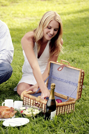 picnicking: A lady picnicking on the field