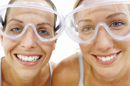Close-up of two women with goggles looking at the camera photo