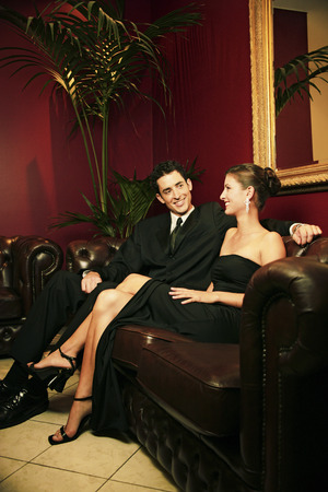 dinner wear: A couple in dinners wear sitting in a waiting room