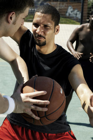 opponent: A man stopping his opponent from passing the ball Stock Photo
