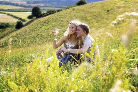 cherishing: A couple drinking wine on the prairie Stock Photo