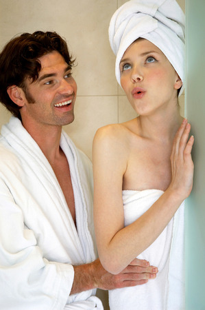 bad breath: A woman disturbing her husband for having a bad breath
