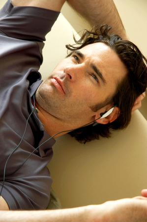 spoiling: A man with hands free lying on the couch Stock Photo