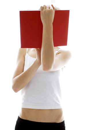 inner wear: A lady in white camisole holding up a book covering her face