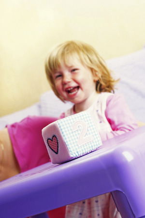 plushie: A young girl playing happily with her toys Stock Photo