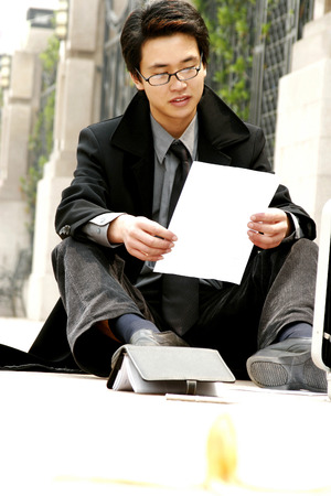 Man sitting on the floor reading after slipped Stock Photo - 26137866