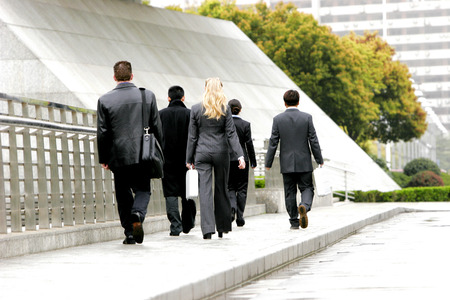 Back shot of a group of sales people walking by the roadside
