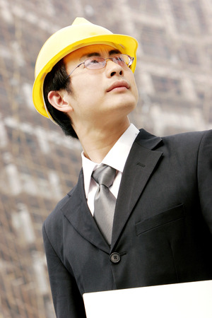 A man with safety helmet at a construction site  photo