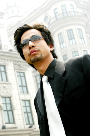 Man in business suit wearing sunglass  photo