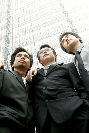 desirous: Three men in office attires Stock Photo